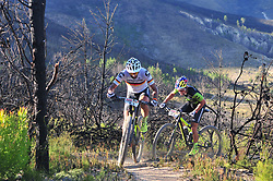 WELLINGTON SOUTH AFRICA - MARCH 23: Manuel Fumic and Henrique Avancini during stage five's 39km time trial on March 23, 2018 in Wellington, South Africa. Mountain bikers gather from around the world to compete in the 2018 ABSA Cape Epic, racing 8 days and 658km across the Western Cape with an accumulated 13 530m of climbing ascent, often referred to as the 'untamed race' the Cape Epic is said to be the toughest mountain bike event in the world. (Photo by Dino Lloyd)