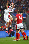 Jonny May of England and Leigh Halfpenny of Wales compete for the ball during the Guinness Six Nations between England and Wales at Twickenham Stadium, Saturday, March 7, 2020, in London, United Kingdom. (Mitchell Gunn-ESPA-Images/Image of Sport)