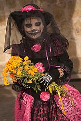 North America, Mexico, Oaxaca Province, Oaxaca, girl in costume for Day of the Dead (Dias de los Muertos) celebration