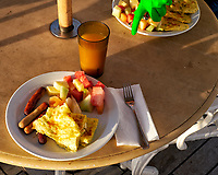 Outdoor breakfast after shooting dawn and sunrise on the  deck of the MV World Odyssey. Image taken with a Fuji X-T1 camera and 35 mm f/1.4 lens (ISO 200, 35 mm, f/7, 1/125 sec).