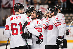 Fabrice Herzog of Switzerland and Andres Ambuhl of Switzerland celebrate after winning during the 2017 IIHF Men's World Championship group B Ice hockey match between National Teams of Canada and Switzerland, on May 13, 2017 in AccorHotels Arena in Paris, France. Photo by Vid Ponikvar / Sportida