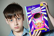 """'EASTER EGGS COULD BRAIN DAMAGE MY SON!'<br /> <br /> LITTLE Ozy Baker is the only one of his friends who is NOT counting the number of chocolate eggs he's been given in the run up to Easter Sunday.<br /> <br /> In fact, nine-year-old Ozy wouldn't know his Mars bar from his Milky Way.<br /> <br /> For the chirpy schoolboy has never been allowed to eat chocolate his entire life - because, if he does, it may cause him brain damage!<br /> <br /> Ozy was born with a rare protein intolerance, which means if he were to eat chocolate, or many other types of food most of us enjoy every day, he would suffer irreparable brain damage.<br /> <br /> Easter is a particularly hard time of year for Ozy with shelves stacked to the rafters with every kind of Easter egg and chocolate figurines imaginable.<br /> <br /> Mum Safia, 44, says: """"Ozy's main diet is fruit and veg - every day is a challenge for him - but Easter is especially difficult because there's all this chocolate being enjoyed around him.<br /> <br /> """"In the past he's got a little teary and asked, 'What doesreal chocolate taste like?' It's heartbreaking as there's no days off with this condition. And Easter is no exception.<br /> <br /> """"He's never registered the different types of chocolate like Kitkats or Mars bars, as he's never tried them.<br /> <br /> """"At Easter he sees a lot a Disney eggs and TV character eggs which he gets excited about until he remembers he cannot have them.<br /> <br /> """"I try to buy Easter eggs that have cups or toys in them of his choice. The chocolate then goes to his dad and sister and he keeps the novelty.<br /> <br /> MORE...<br /> <br /> When Ozy was just seven-years-old, mum Safia sat him down in front of the computer and clicked onto a YouTube site.<br /> <br /> But the images which filled the screen were not kiddies' cartoons - but real-life images of adults with severe brain damage.<br /> <br /> This may seem extreme, but for mum Safia it was the only way she felt she could guarantee"""