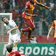 Galatasaray's Johan Elmander, Emmanuel Eboue (Top) and CFR Cluj's Luis Alberto during their UEFA Champions League Group H matchday 3 soccer match Galatasaray between CFR Cluj at the TT Arena Ali Sami Yen Spor Kompleksi in Istanbul, Turkey on Tuesday 23 October 2012. Photo by Aykut AKICI/TURKPIX