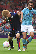 Men's Olympic Football match Spain v Japan on 26.7.12...Hiroki Sakai of Japan and Lopez Adrian of Spain, during the Spain v Japan Men's Olympic Football match at Hampden Park, Glasgow...Picture John Millar / ProLens PhotoAgency / PLPA.Thursday 26th July 2012......................