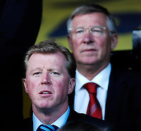 Photo: Richard Lane.<br />Watford v West Ham United. The Barclays Premiership. 22/08/2006. England manager, Steve McClaren watches on with Manchester United manager, Sir Alex Ferguson behind him.