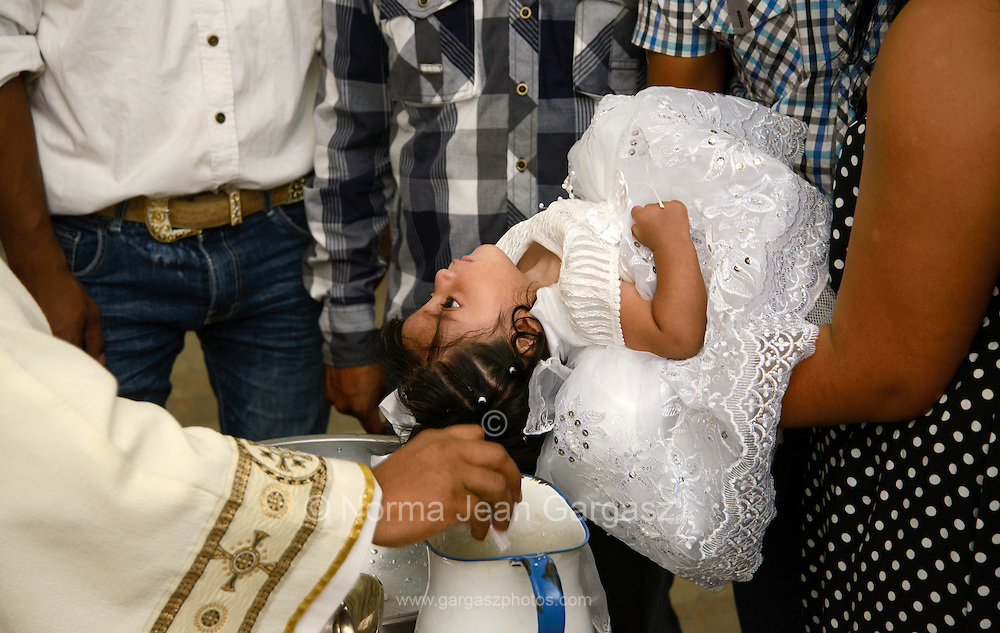 A Baptism ceremony is performed at Parroquia la Purisma Concepcion, a Catholic church in Nogales, Sonora, Mexico.