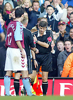 26/12/2004 - FA Barclays Premiership - Chelsea v Aston Villa - Stamford Bridge<br />The crowd go wild as the referee Peter Walton checks on his assistant Paul Norman after he falls whilst running along the touchline<br />Photo:Jed Leicester/Back Page Images