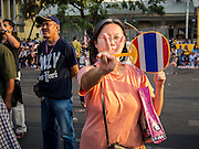 """14 DECEMBER 2013 - BANGKOK, THAILAND:  A woman flashes the """"V for Victory"""" symbol during an anti-government rally in Bangkok. The Thai anti-government movement, called the People's Democratic Reform Committee (PRDC) sponsored a forum Saturday to establish guidelines for political reform in Thailand. The opposition leader, Suther Thaugsuban, said his movement will not participate in a similar forum, sponsored by the government scheduled for Sunday. Thailand's political impasse continues with the opposition calling for the caretaker government of Prime Minister Yingluck Shinawatra to step down. Yingluck has, so far, refused to step down from her caretaker roll. Crowds at the anti-government rallies have shrunk substantially since the collapse of the government earlier in the week.       PHOTO BY JACK KURTZ"""