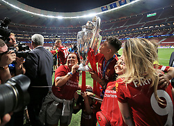 Liverpool's Roberto Firmino and family celebrate with the trophy after winning the UEFA Champions League Final at the Wanda Metropolitano, Madrid.