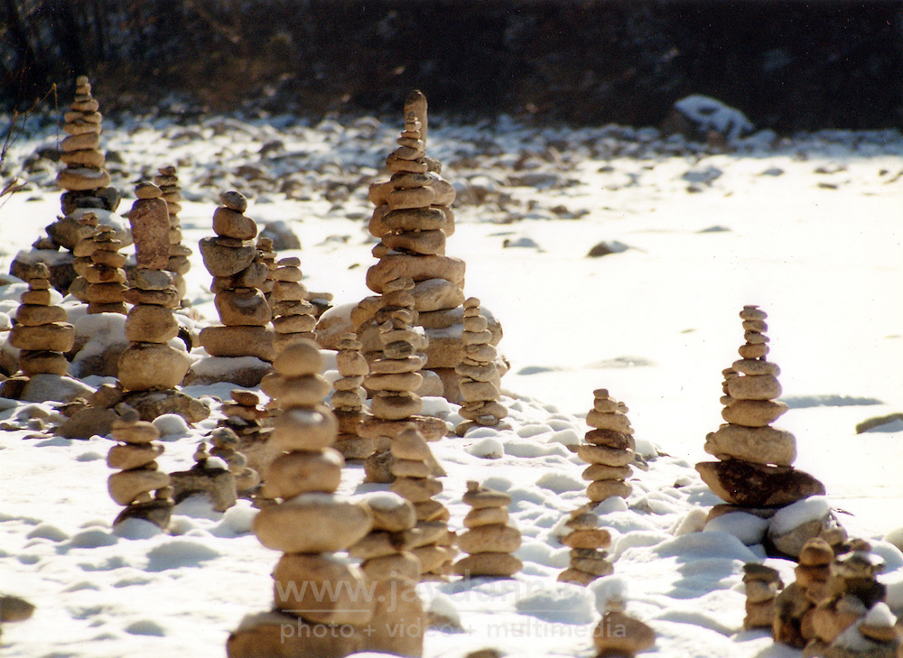 """South Korea, Sokcho, 2001. """"Doltap,"""" or Buddhist prayers made with stones, beside a frozen riverbank deep in South Korea's forested eastern seacoast."""
