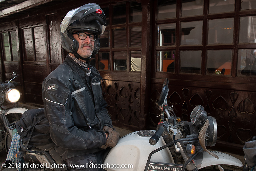 Corey Froschheuser on the main street of Tatopani before starting out on Day-7 of our Himalayan Heroes adventure riding from Tatopani to Pokhara, Nepal. Monday, November 12, 2018. Photography ©2018 Michael Lichter.