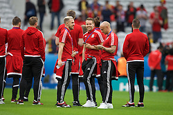 LILLE, FRANCE - Friday, July 1, 2016: Wales Aaron Ramsey and Chris Gunter share a joke on the pitch ahead of the pre-match warm-up before the UEFA Euro 2016 Championship Quarter-Final match against Belgium at the Stade Pierre Mauroy. (Pic by Paul Greenwood/Propaganda)
