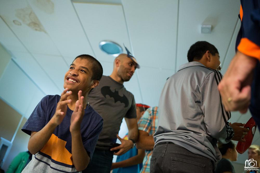 Milpitas High sophomore Mike Joshua Eronuevo dances during the Best Buddies Special Education Dance at Milpitas High School in Milpitas, California, on April 21, 2017. (Stan Olszewski/SOSKIphoto)