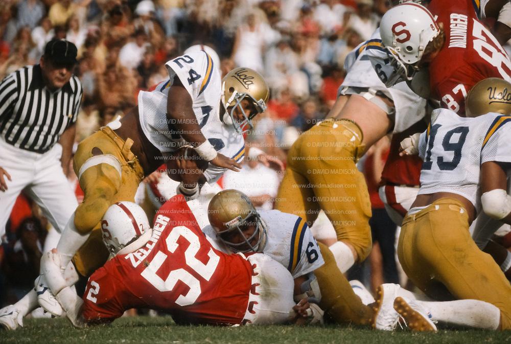 COLLEGE FOOTBALL:  Stanford vs UCLA on October 6, 1979 at Stanford Stadium in Palo Alto, California.   Freeman McNeil #24 UCLA, Craig Zellmer #52, Stanford.   Photograph by David Madison | www.davidmadison.com