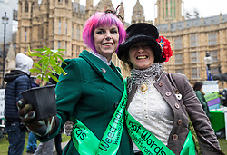 © Licensed to London News Pictures. 23/02/2018. London, UK. Two women stand with a cannabis plant opposite Parliament during a protest in support of the legalisation of cannabis for medicinal use as MPs debate the issue in The House of Commons. Photo credit: Rob Pinney/LNP