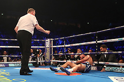 Tony Bellew is knocked down in the eighth round by Oleksandr Usyk during their WBC, WBA, IBF, WBO & Ring Magazine Cruiserweight World Championship bout at Manchester Arena.