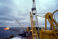 Stock photo of waste gas being burned offshore on a drill rig.