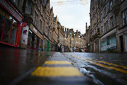 Edinburgh, Scotland, UK. 5 January 2020. Views of a virtually deserted Edinburgh City Centre as Scotland wakes up to the first day of a new strict national lockdown announced by Scottish Government to contain new upsurge in Covid-19 infections. Pic; Cockburn Street in Old Town almost deserted with all shops closed.  Iain Masterton/Alamy Live News