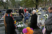 PKazimierz, Poland cemetery on All Saints Day. Wiezowski/Ledochowicz family visits relatives' graves. Borys is reunited with his dead father's brother, who has emotional problems and is in a wheelchair because he has one leg.
