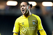 Coventry City midfielder Jodi Jones (7) questions the linesman during the EFL Trophy match between Milton Keynes Dons and Coventry City at Stadium:MK, Milton Keynes, England on 3 December 2019.