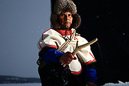 Nils Mathis N. Vars fishes on his lake, Láhpojávri, as he has all his 75 years, with traditional birch stick and fishing line.