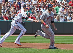 June 4, 2017 - Baltimore, MD, USA - Baltimore Orioles' Manny Machado, left, tags out Boston Red Sox's Mitch Moreland in a run down between second and third bases in the first inning on Sunday, June 4, 2017 at Oriole Park at Camden Yards in Baltimore, Md. The Red Sox defeated the Orioles 7-3. (Credit Image: © Kenneth K. Lam/TNS via ZUMA Wire)