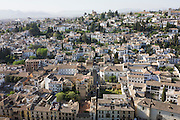 Aerial landscape of old Arab Albaicin quarter and surrounding barrios of Moorish city of Granada.