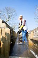 King Willem-Alexander and Queen Maxima of The Netherlands volunteering at playground and community Vreugdeoord in Alpen aan den Rijn, The Netherlands, 12 March 2016. NL Doet is in initiative of the Oranje Fonds, the King and Queen are patron and patroness of the foundation. Photo: robin utrecht <br /> Koning Willem-Alexander en Koningin Maxima nemen deel aan vrijwilligersactie NL Doet en klussen mee in speeltuin en buurtvereniging Vreugdeoord in Alpen aan den Rijn, 12 Maart 2015. NL Doet is een vrijwilligersactie van het Oranje Fonds, de koning en de koningin zijn beschermheer en beschermvrouwe van het fonds. Foto: robin utrecht  <br /> Koning Willem-Alexander en Hare Majesteit Koningin Máxima en leden van de Koninklijke Familie hebben op vrijdag 11 maart en zaterdag 12 maart deelgenomen aan NLdoet van het Oranje Fonds, de grootste vrijwilligersactie van Nederland.<br />  Koning Willem-Alexander en Koningin Máxima zijn zaterdag aan de slag gegaan bij speeltuin- en buurtvereniging Vreugdeoord in Alphen aan den Rijn. Deze buurt- en speeltuinvereniging bestaat al sinds 1951 en is dé ontmoetingsplek voor de buurt. De Koning en Koningin hebben meegewerkt aan het kruien van nieuw zand naar de zandbak en het reinigen van de speeltoestellen. Prinses Beatrix, Prins Constantijn, Prins Floris en Prinses Aimée hebben zich op vrijdagochtend ingezet bij de Prinses Máxima Manege in Den Dolder, een hippisch therapeutisch centrum voor mensen met en zonder een beperking. Wekelijks komen zo´n 200 kinderen en volwassenen met een lichamelijke, zintuiglijke of psychische beperking naar de manege om met behulp van paarden hun welzijn te bevorderen.<br /> De Koninklijke Familie ging aan de slag met timmer- en schilderwerk, het begaanbaar maken van bospaden voor ruiters en hun begeleiders en het rijden met een huifbed voor mensen met een meervoudige beperking.<br /> Prinses Margriet en prof.mr. Pieter van Vollenhoven hielpen vrijdagmiddag mee in het Brandweer- en Stormrampenmuseum in Borcul