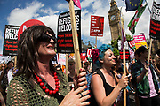 Happy dancing singing demonstrators at the Peoples Assembly demonstration arrives in Parliament Square: No More Austerity - No To Racism - Tories Must Go, on Saturday July 16th in London, United Kingdom. Tens of thousands of people gathered to protest in a march through the capital protesting against the Conservative Party cuts. Almost 150 Councillors from across the country have signed a letter criticising the Government for funding cuts and and will be joining those marching in London. The letter followed the recent budget in which the Government laid out plans to cut support for disabled people while offering tax breaks for big business and the wealthy. (photo by Mike Kemp/In Pictures via Getty Images)