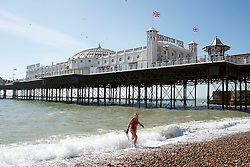 © Licensed to London News Pictures. 29/03/2014. Brighton, UK. Brighton swimming club members enjoy a dip in the sea.  People enjoy the sunny weather in Brighton today 29th March 2014. The warm weather is forecast to remain into next week. Photo credit : Stephen Simpson/LNP