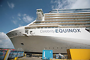 Celebrity Equinox, a brand new cruise ship belonging to Celebrity Cruises, during her river conveyance down the River Emms from the shipyard where she was built to the open sea..Ship at ship builders in Papenburg.