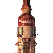 Model in the shape of a bottle representing a bar. Ray Massey is an established, award winning, UK professional photographer, shooting creative advertising and editorial images from his stunning studio in a converted church in Camden Town, London NW1. Ray Massey specialises in drinks and liquids, still life and hands, product, gymnastics, special effects (sfx) and location photography. He is particularly known for dynamic high speed action shots of pours, bubbles, splashes and explosions in beers, champagnes, sodas, cocktails and beverages of all descriptions, as well as perfumes, paint, ink, water – even ice! Ray Massey works throughout the world with advertising agencies, designers, design groups, PR companies and directly with clients. He regularly manages the entire creative process, including post-production composition, manipulation and retouching, working with his team of retouchers to produce final images ready for publication.