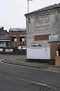 Old advertising on a wall in Birmingham, United Kingdom.