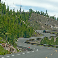 A highway curves through Yellowstone National Park, Wyoming.