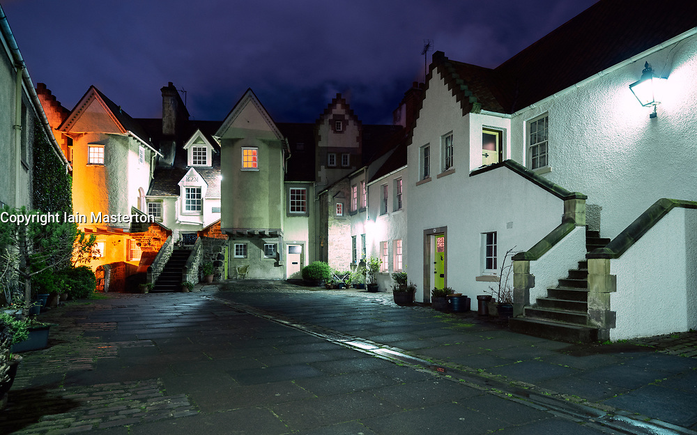 View of old houses and courtyard at White Horse Close at night in Edinburgh Old Town, Scotland, UK
