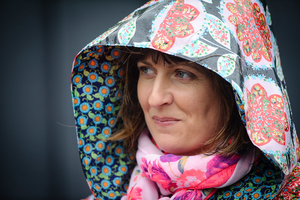 WELLINGTON, NEW ZEALAND - December 07:  Angela Nicol from OTT Designer Coats looks out at the crowds braving the heavy rain at the Thorndon Fair 2014. December 07, 2014 in Wellington, New Zealand.  REAL PEOPLE.  (Photo by Mark Tantrum/ real-people.co.nz)