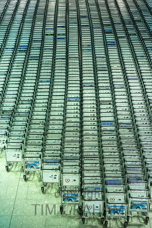 Generic shot of hundreds of luggage trolleys at an airport