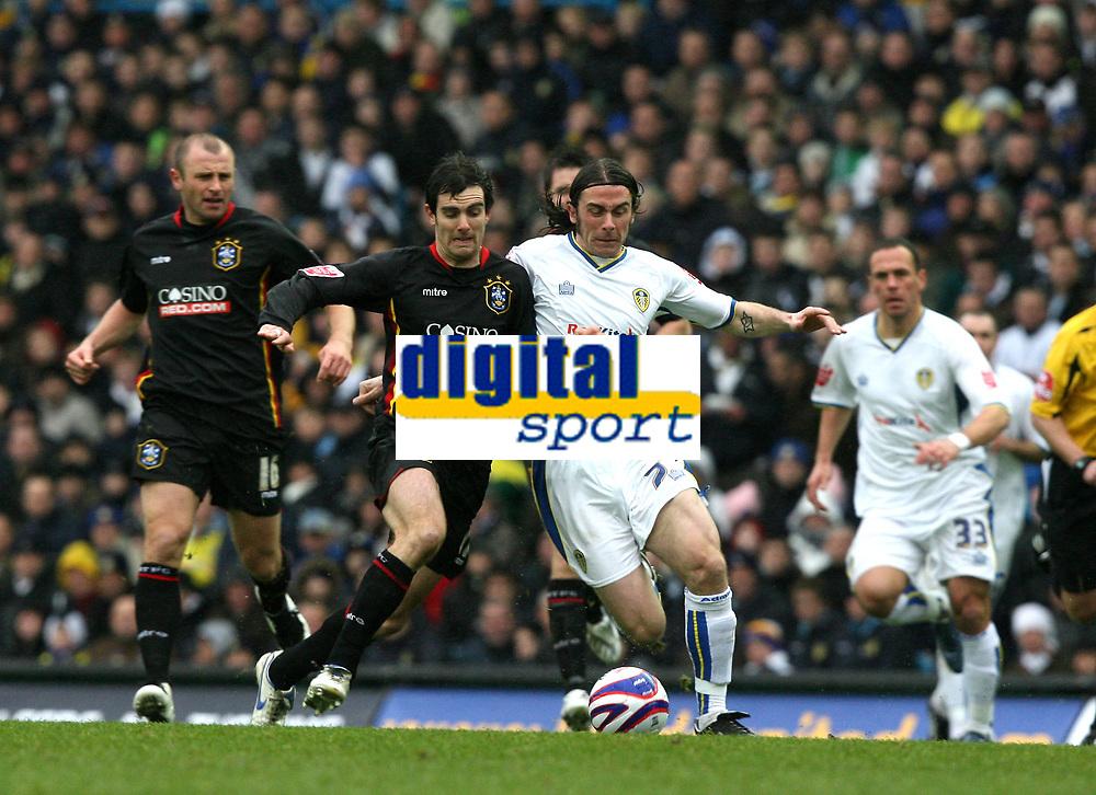 Photo: Paul Greenwood/Sportsbeat Images.<br />Leeds United v Huddersfield Town. Coca Cola League 1. 08/12/2007.<br />Huddersfield's Danny Schofield (L) goes shoulder to shoulder with Leeds David Prutton