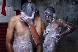 November 10, 2018 - Jakarta, Indonesia - Mental patient reacts as they is given a shower at the Jamrud Biru foundation house in East Bekasi near Jakarta, Indonesia, on Saturday, November 11, 2018. Jamrud Biru is a small private foundation focused on treating the mentally-ill. The foundation give patients a shelter to stay, treat them with prayers and traditional medicine, and feed them vegetarian food. Most of them became mentally ill due to the poor economy. (Credit Image: © Andrew Lotulung/NurPhoto via ZUMA Press)