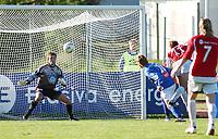 Are Brodtkorb, Kongsvinger, scorer mot Kim Deinoff, Aalesund. <br /> <br /> Fotball: Kongsvinger - Aalesund 2-2 (5-2 e. straffer). NM 2004 herrer, 3. runde. 8. juni 2004. (Foto: Peter Tubaas/Digitalsport.