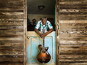 A blues guitarist, Macavine Hayes with his guitar at the Music Makers Organization home base in Hillsborough North Carolina.