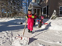 Paul, Jazmyn and Aleck Swenson shovel out their home after Thursday nights nor'easter.  (Karen Bobotas/for the Laconia Daily Sun)