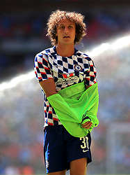 """Chelsea's David Luiz during the warm up before the Community Shield match at Wembley Stadium, London. PRESS ASSOCIATION Photo. Picture date: Sunday August 5, 2018. See PA story SOCCER Community Shield. Photo credit should read: Mike Egerton/PA Wire. RESTRICTIONS: EDITORIAL USE ONLY No use with unauthorised audio, video, data, fixture lists, club/league logos or """"live"""" services. Online in-match use limited to 75 images, no video emulation. No use in betting, games or single club/league/player publications."""