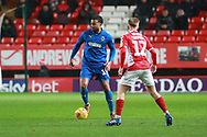AFC Wimbledon midfielder Tom Soares (19) taking on Charlton Athletic midfielder Ben Reeves (12) during the EFL Sky Bet League 1 match between Charlton Athletic and AFC Wimbledon at The Valley, London, England on 15 December 2018.