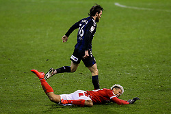 Lyle Taylor of Nottingham Forest is fouled by Jonathan Howson of Middlesbrough - Mandatory by-line: Robbie Stephenson/JMP - 20/01/2021 - FOOTBALL - City Ground - Nottingham, England - Nottingham Forest v Middlesbrough - Sky Bet Championship