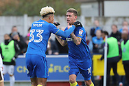 AFC Wimbledon striker Lyle Taylor (33) celebrating after scoring goal with AFC Wimbledon striker Cody McDonald (10)during the EFL Sky Bet League 1 match between AFC Wimbledon and Walsall at the Cherry Red Records Stadium, Kingston, England on 25 November 2017. Photo by Matthew Redman.