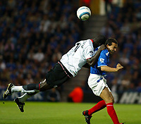 Fotball<br /> England<br /> Foto: SBI/Digitalsport<br /> NORWAY ONLY<br /> <br /> Portsmouth v Fulham<br /> <br /> Barclays Premiership. 30/08/2004<br /> <br /> Eyal Berkovic of Portsmouth goes up for an aerial ball with Papa Bouba Diop of Fulham