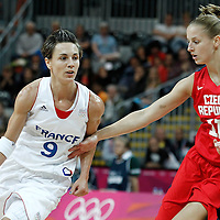 07 August 2012: France Celine Dumerc drives past Czech Republic Katerina Elhotova during 71-68 Team France victory over Team Czech Republic, during the women's basketball quarter-finals, at the Basketball Arena, in London, Great Britain.