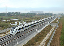 """File photo taken on Dec. 29, 2015 shows a bullet train running on the western part of a loop line of Hainan high-speed railway in south China's island of Hainan Province. """"Building more high-speed railways"""" has been a hot topic at the annual sessions of China's provincial legislatures and political advisory bodies intensively held in January. China has the world's largest high-speed rail network, with the total operating length reaching 19,000 km by the end of 2015, about 60 percent of the world's total. The expanding high-speed rail network is offering unprecedented convenience and comfort to travelers, and boosting local development as well. Chinese companies have developed world-leading capabilities in building high-speed railways in extreme natural conditions. High-speed railway routes across China have been designed to suit its varying climate and geographical conditions. The Harbin-Dalian high-speed railway travels through areas where the temperature drops to as low as 40 degree Celsius below zero in winter, the Lanzhou-Xinjiang railway passes through the savage Gobi Desert and the Hainan Island railway can withstand a battering from typhoons. The China Railway Corp. plans to spend another 800 billion yuan (around 120 billion U.S. dollars) in 2016, especially in less-developed central and western regions. EXPA Pictures © 2016, PhotoCredit: EXPA/ Photoshot/ Xing Guangli<br /><br />*****ATTENTION - for AUT, SLO, CRO, SRB, BIH, MAZ only*****"""