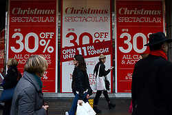 © Licensed to London News Pictures.05/12/2013. London, UK. Pre-Christmas sale sings on a high street department store on Oxford Street.Photo credit : Peter Kollanyi/LNP